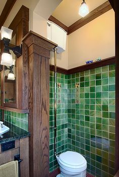 In the bathroom shown, millwork creates a column and capital dividing the space. Photo by Christian Korab.
