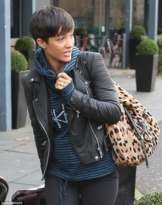 Stylish: The Saturdays star wowed in a stylish black leather jacket over a blue-and-black ...