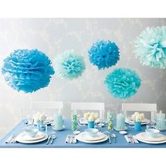Various shades of blue tissue paper pom poms like this for over the buffet table