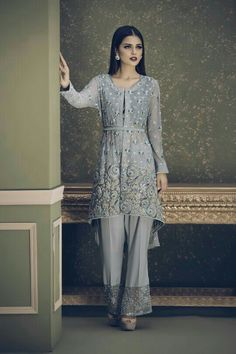 Ayesha Ibrahim is back at it again with her exquisitely made brand new collection- featuring chic cuts and silhouettes, pastel color schemes and delicate embellishments rendering the pieces in this… Trajes Pakistani, Pakistani Formal Dresses, Pakistani Party Wear, Pakistani Fashion Casual, Pakistani Wedding Outfits, Pakistani Dress Design, Indian Dresses, Asian Fashion, Stylish Dresses
