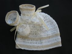This hat and booties set is hand crocheted with white and natural-colored fine cotton thread. Booties/ballet slippers are decorated with ivory-colored ribbon.  Please select desired size from the drop down menu. Hat: Preemie-Newborn - 13 0-3 months- 14 3-6 months - 15  Booties: Preemie-Newborn- 3 sole 0-3 months - 3 1/2 3-6 months - 4  Other sizes available. Please request. Custom orders welcome.  Comes from pet/smoke-free environment. Please have a look at my other items. I wi...