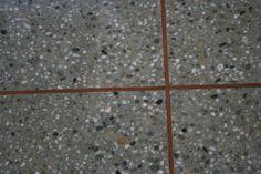 Copper bands in concrete floor.