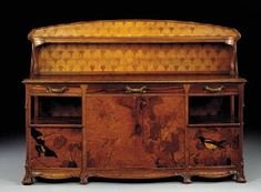CARVED MAHOGANY AND MARQUETRY SIDEBOARD* LOUIS MAJORELLE, CIRCA 1905