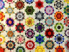 English paper pieced Rose-Star quilt top...I am diggin' the kaleidoscope quality of this quilt!