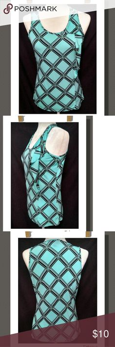 Sleeveless Top Cute patterned sleeveless  top with a decorative flowy side trim. Great clors!  95% Polyester 5% Spandex Worthington Tops