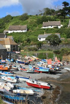 #Cadgwith is one of the most beautiful fishing villages in #Cornwall - this picture shows the little harbour at low tide.