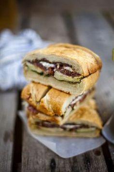 Pressed Picnic Sandwich - artichoke hearts, basil, ciabatta bread, goat cheese, prosciutto, spinach, sundried tomatoes