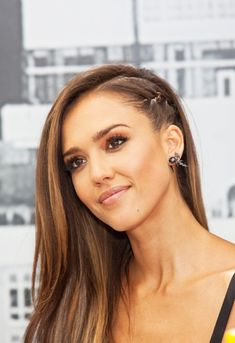 Jessica Alba with a cornrow plait and sideswept hair at Comic Con July 2014