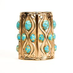 "DESCRIPTION  Fit for a Queen or GoddessRare Napier Repousse Cuff Bracelet,Gold Tone with Faux Turquoise CabochonsIncredible FindAmazing Style and PresenceThis piece is a book piece and is featured on page 283 or Melinda's Lewis's Book ""The Napier Company: Defining 20th Century American Costume Jewelry""DETAILS1950s EraDesigner, NapierRepousse Inspired Gold Tone with Faux Turquoise Glass Art Glass CabochonsPush In ClaspExcellent Vintage ConditionMEASUREMENTS3 1/2"" Tall x 7 1/4"""