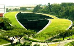 The School of Art, Design and Media at Nanyang Technological University in Singapore displays an amazing swirling green roof where students can have lunch and study sessions. Blending nature and hi-tech, this building stands up to the creativity it accommodates and acts as a factor of attraction for new students every year.