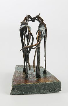 Kiss by Sandy Graves: Bronze Sculpture.  The skinny sculptures fascinate me....it's as though they are merely skeletal and your mind can finish if you desire fleshing out....or not.... K.W.