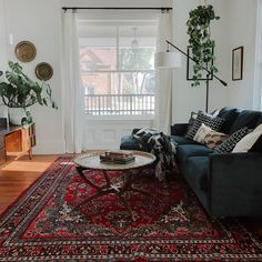 A Modern Moody Victorian Home at Christmas Miranda Schroeder Red Persian Rug Living Room, Blue Velvet Sofa Living Room, Navy Living Rooms, Black And White Living Room, Living Room Sofa, Rugs In Living Room, Navy Blue Velvet Sofa, Black Sofa Living Room Decor, Navy Couch