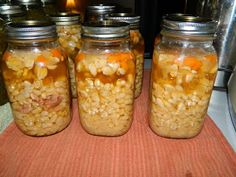 Navy Bean Soup 2 lbs dry navy beans, rinsed half of small onion diced 1-2 medium carrots diced 1 stalk of celery diced 1 cup of diced ham chicken bouillon, powder hickory smoked salt water 7 quart jars, lids and rings