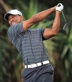 Golfer Tiger Woods and Sprinter Shelly-Ann Fraser-Pryce Voted Athletes of the Month for May 2013