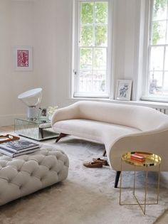 love the mirrored table + gold sidetable. All White Room, Living Room White, Cozy Living, Home Living Room, Living Room Decor, Upholstered Furniture, Dining Room Furniture, Furniture Design, Tufted Ottoman