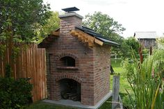 Wood fired pizza oven for the home. Totally doing this one day!