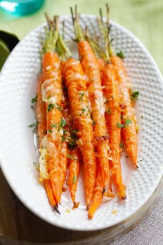 Garlic Parmesan Roasted Carrots - Oven roasted carrots with butter, garlic and Parmesan cheese. The easiest and most delicious side dish ever!