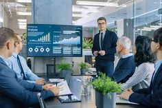 Young Stock Trader Shows to the Executive Managers Cryptocurrency and Trade Market Correlation Pointing at the Wall TV. Shows Trade Market, Stock Market, Job Website, Stock Trader, Corporate Law, Cryptocurrency Trading, Financial Institutions, Stock Photos, Business