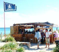 Pirate flagged beach bar... Spain...