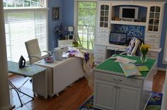 Kimberly Einmo's sewing room - love the ironing table next to the sewing machine.