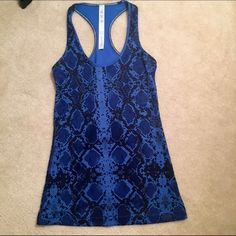 Never worn Lululemon tank Reptile skin design and the deep blue makes this one hot tank. lululemon athletica Tops Tank Tops