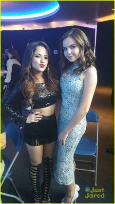 Becky G sparkles on the red carpet in a cool white dress at the 2014 American Music Awards held at the Nokia Theatre L.A. Live on Sunday (November 23) in Los Angeles.The 17-year-old rapper ran into Bailee Madison at the pre-show, where she performed ahead of the show.