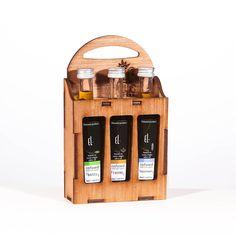coffret de flacons d'huiles d'olive infusées à froid différents ingrédients: ail, basilic, citron, sauge, origan ...