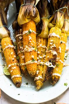 This Grilled Mexican Street Corn is grilled to smoky perfection then smothered in a delicious and creamy vegan mayonnaise blend and Lime Crema. It's the best side dish! | http://jessicainthekitchen.com - potluck at ohmyveggies.com