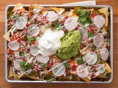 These fully loaded nachos that needed a whole dang sheet pan to live their best life: | 21 Nachos That Changed The World In 2014