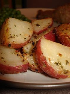 Garlic Roasted Red Potatoes...2 pounds red potatoes, quartered 1/4 cup butter, melted 2 teaspoons minced garlic 1 teaspoon salt 1 lemon, juiced 1/2 teaspoon dried parsley 1 tablespoon grated Parmesan cheese (I used 2 tablespoons)