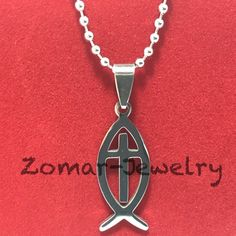 Christian Fish Cross Necklace 316 Stainless Steel High Quality Pendant it measures at 1.3 inches long and .50 inches wide the chain is a little over 21 inches. Zomar Jewelry Necklaces