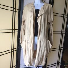 Urban Outfitters Cope Tan Long Open Cardigan Small Urban Outfitters Cope Tan Long Open Cardigan Small. 100% Silk linen. Lightweight, great layering piece. Bought at Urban Outfitters. Urban Outfitters Jackets & Coats