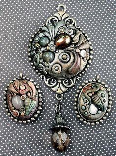 *POLYMER CLAY ~ Metallic Filigree Pendants, via Flickr.