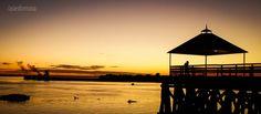 Amanecer en la costanera sobre el Río Paraguay