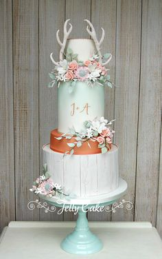 Based around a lovely wedding invitation this cake incorporates crackled wood, rose gold, watercolour and monogram and finished with rustic flowers and sugar antlers.