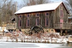 Old Water Mill In Waterloo, Ontario In Snowy Day. Picture of old (historical building) grist (flour) mill in Waterloo Ontario on almost frozen Beaver Creek in snow cold winter day. Photo Clipart, Waterloo Ontario, Canada Holiday, Living In Arizona, Water Mill, Beaver Creek, Snowy Day, Largest Countries, Old Barns