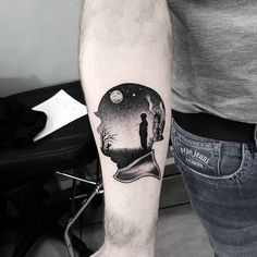 Double exposure soldier head tattoo on the right inner forearm.