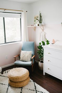 25 Smartest And Most Functional IKEA Nursery Hacks :: an IKEA Poang chair re-upholstered in blue and stained to fit the nursery decor