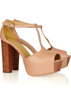 Obsessed.  See by Chloe leather and wood sandals.
