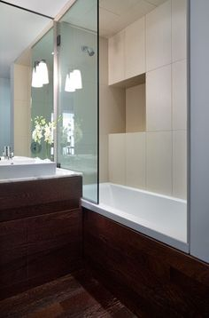 I want this glass shower wall....no messing with tacky sliding doors or curtains. Although a frameless glass door would also look nice