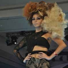 Big, textured blonde and brunette hair from Latvia at the World of Hairdressing Farouk Conference in Cancun.