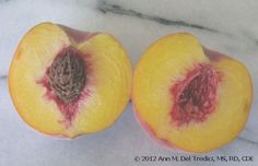 Peaches: Freestone Summer Flame peach from the Farmers' Market today~wonderful balance of acid and sweet. Photo © 2012 Ann M. Del Tredici, MS, RD, CDE