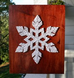 I love Christmas, I love snow, I LOVE decorating! This white snowflake glows against the wood background. This is perfect for Christmas decor,