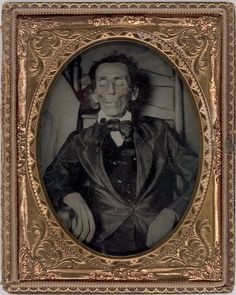 ca. 1860's, [post-mortem ambrotype portrait of a gentleman in a chair]        via Cowan's Auctions