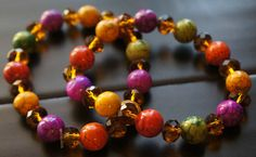 This bracelet is made with 9mm glass crystal beads and 11mm multi colored marble beads. on Etsy, $10.00