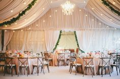 Elegant Draped Reception with Chandeliers and Garlands   onelove photography   Bold Colors and Modern Sparkle in Palm Springs for a Glam Desert Wedding - http://heyweddinglady.com/bold-colors-and-modern-sparkle-in-palm-springs/