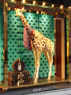 Louis Vuitton. Kids room inspiration.velvet tufted.oversized giraffe. Stacked LV trunks.