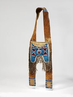 Shoulder Bag Date: ca. 1845 Geography: United States, Texas or Oklahoma Culture: Comanche or Kiowa Medium: Native-tanned leather, glass beads, wool cloth Native American Regalia, Native American Crafts, Native American Artifacts, Native American Beadwork, American Indian Art, Comanche Indians, Plains Indians, Shooting Bags, Leather Workshop