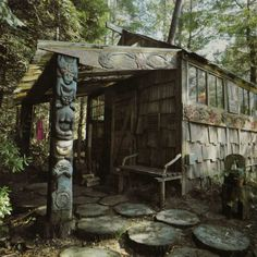 Cabin with carvings, tree stump path