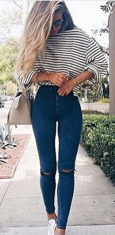 #spring #outfits woman wearing white and black stripes long-sleeved top and distressed skinny jeans. Pic by @fashionloovy